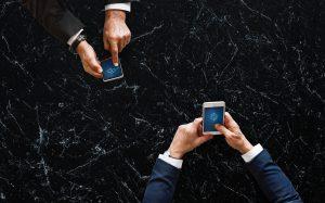 people on iphones