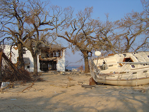 hurricane katrina disaster with broken home and boat