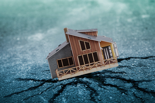 tiny house on broken pavement