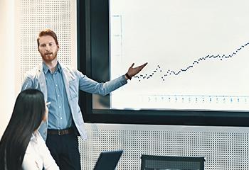 man presenting a graph