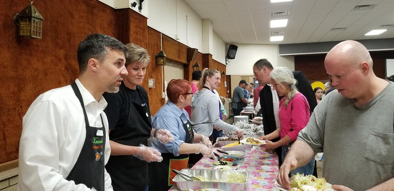 helping serve food