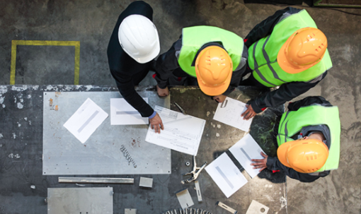Construction workers looking at papers
