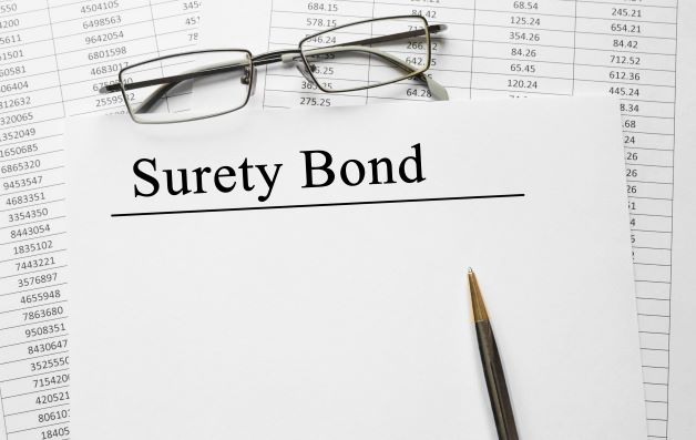 Surety bond with glasses and pencil