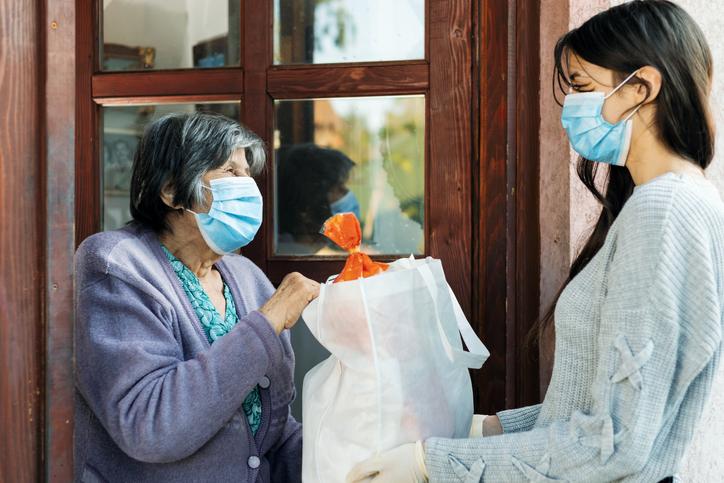 Nonprofit worker helping community member